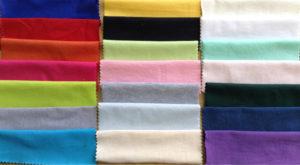 Образцы тканей на листе бумаги