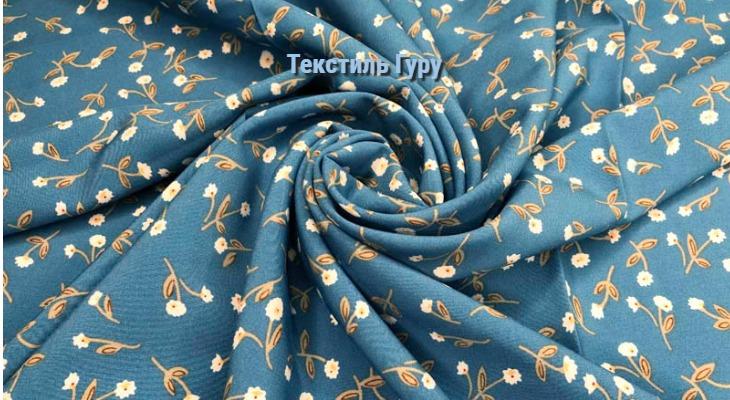 Ткань район мелкие цветы на голубом