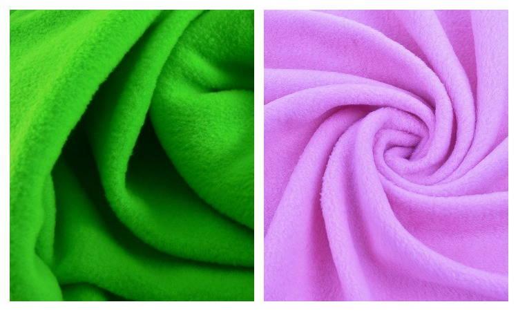 Ткань флис зеленого и сиреневого цвета